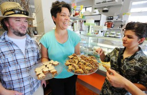Farm To Table owner/tour operator Donald Fraser and Black Honey owner Lisa Dixon offer desserts to Catherine Hanrahan of Kruz FM during the Farm To Table Peterborough Downtown Culinary Tour on June 26, 2013 at the Black Honey Bakery on Hunter St. W. The tour is back on Wednesday afternoons this summer and is expanding with forays into East City and possibly some evening and regional treks. Clifford Skarstedt/Peterborough Examiner/QMI Agency file photo.