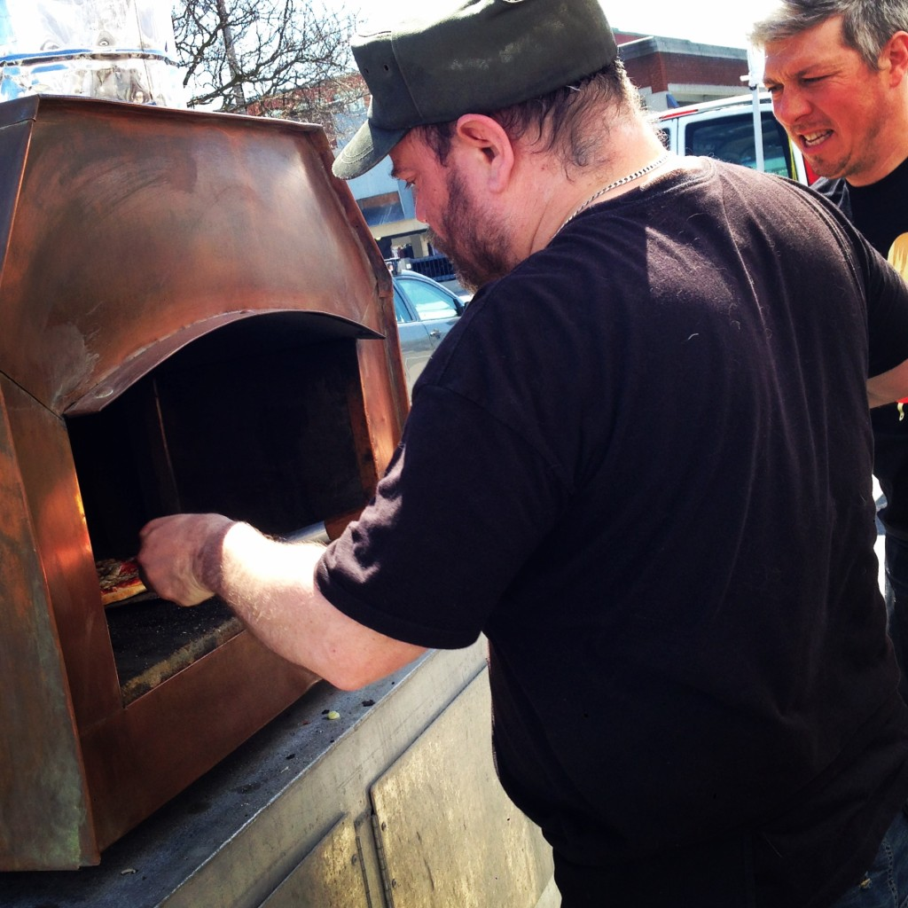 Hot stuff!  Wood-fired pizza fills the air with a smokey savoury aroma.