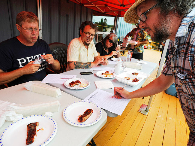 David Russell, Brian Henry, Shari Darling and I (with the straw hat) go through a double-blind process during the second annual Kawartha Barbeque Competition, back in 2013 at Friendly Fires on Highway 7 in Peterborough. Photo courtesy of Clifford Skarstedt/Peterborough Examiner/QMI AGENCY.