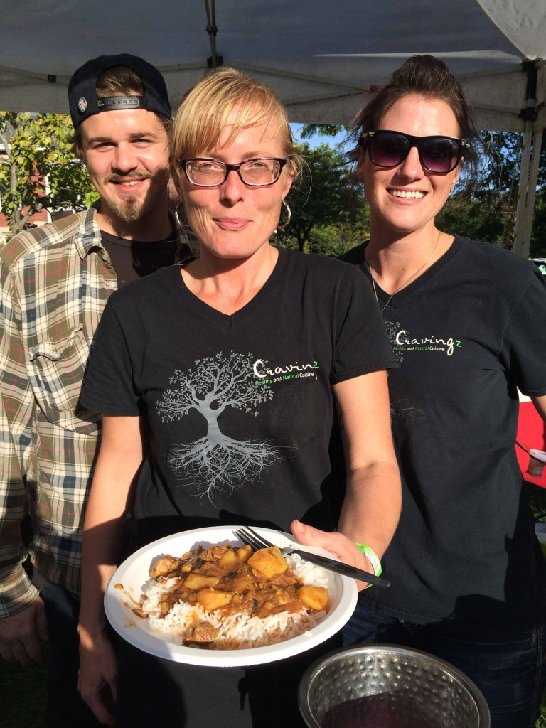 Heather Harrison, flanked by assistants Sonia and Spencer, serves up an autumn lamb curry at the Cultivate Festival.